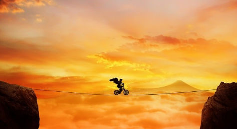 cyclist on a high wire